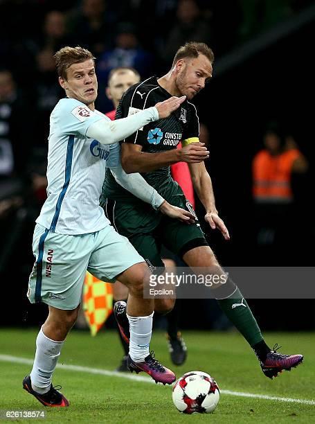 Andreas Granqvist of FC Krasnodar is challenged by Aleksandr Kokorin of FC Zenit St Petersburg during the Russian Premier League match between FC...