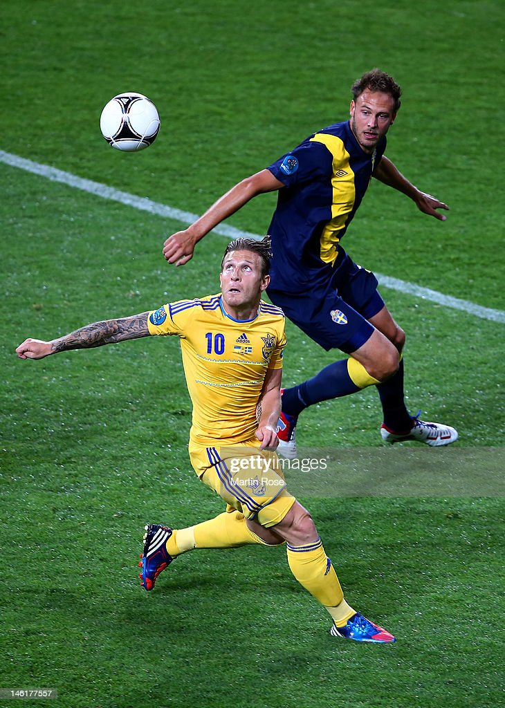 Andreas Granqvist of Sweden and Andriy Voronin of Ukraine compete for the ball during the UEFA EURO 2012 group D match between Ukraine and Sweden at...
