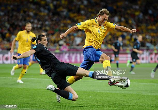 Andreas Granqvist of Sweden is tackled by Andy Carroll of England during the UEFA EURO 2012 group D match between Sweden and England at The Olympic...