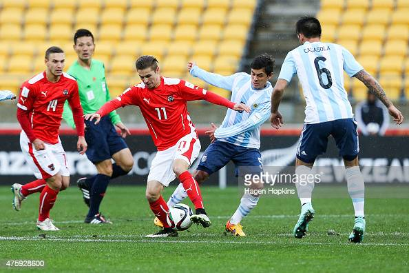 Andreas Gruber of Austria holds off Adrian Cubas of Argentina during the FIFA U20 World Cup New Zealand 2015 Group B match between Austria and...