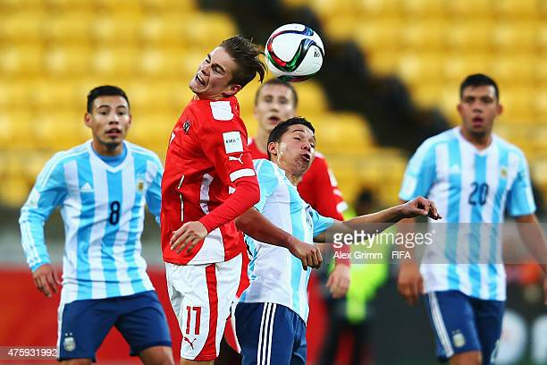 Andreas Gruber of Austria jumps for a header with Tomas Martinez of Argentina during the FIFA U20 World Cup New Zealand 2015 Group B match between...