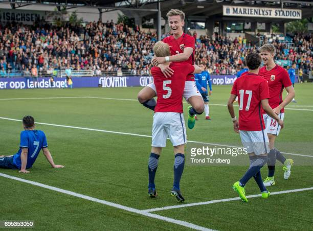 Andreas HancheOlsen celebrate goals with Erlend Reitan Rafik Zekhnini Kristoffer Ajer of Norway during the Qualifying Round European Under 21...