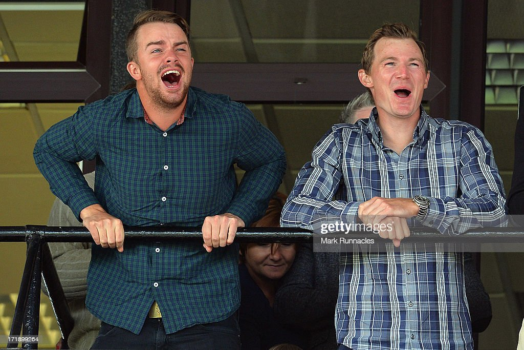 Andreas Harto of Denmark (L) and Lasse Jensen of Denmark attend The Dubai Duty Free Irish Derby after the Third Round of the Irish Open at Carton House Golf Club on June 29, 2013 in Maynooth, Ireland.