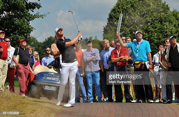 Andreas Harto of Denmark plays a chip shot to the 18th green during the first round of the BMW International Open Previews at Golf Club Gut...