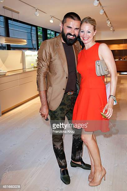 Andreas Haumesser and Kathrin Schira attend the Bulthaup Showroom Opening on July 03 2014 in Munich Germany