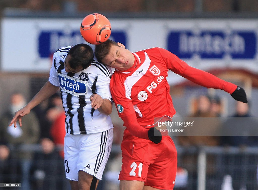 Andreas Hofmann of Aalen and Thomas Kurz of Regensburg battle for the ball during the Third League match between VfR Aalen and Jahn Regensburg at the...