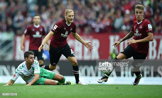 Andreas Hofmann of Fuerth Hanno Behrens of Nuernberg and Ondrej Petrak of Nuernberg tussle for the ball during the Second Bundesliga match between 1...