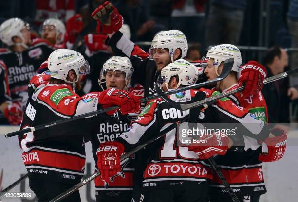 Andreas Holmqvist of Koeln celebrates with team mates after scoring his teams first goal during the DEL semi final playoff game between Koelner Haier...