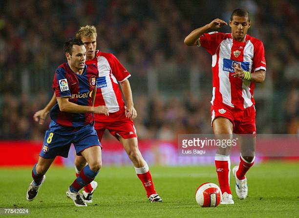 Andreas Iniesta of Barcelona and Felipe Melo and Mane of Almeria in action during the La Liga match between FC Barcelona and UD Almeria played at the...
