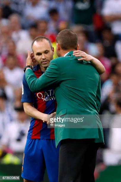 Andreas Iniesta of FC Barcelona shakes hands with Sergio Garcia during the La Liga match between Real Madrid CF and FC Barcelona at the Santiago...