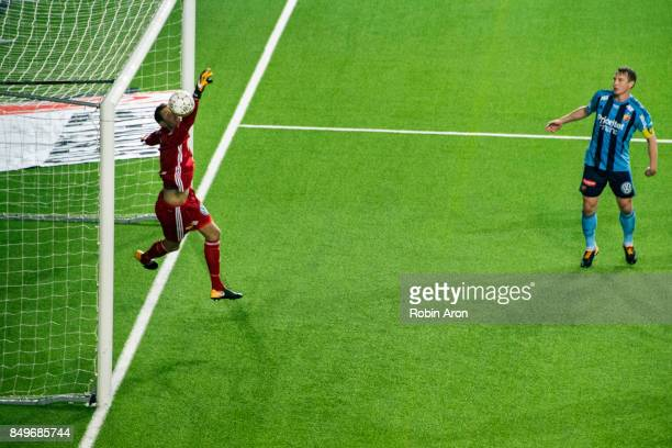 Andreas Isaksson goalkeeper of Djurgardens IF does a big save and Kim Kallstrom watching during the Allsvenskan match between IF Elfsborg and...