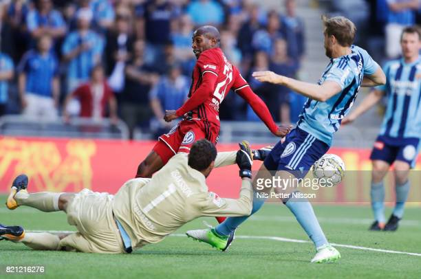Andreas Isaksson of Djurgardens IF makes a save on a shot by Fouad Bachirou of Ostersunds FK during the Allsvenskan match between Djurgardens IF and...