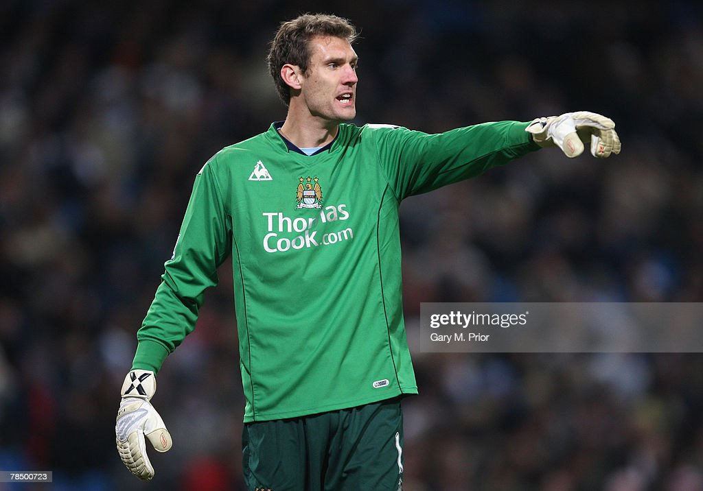 http://media.gettyimages.com/photos/andreas-isaksson-of-manchester-city-shouts-instructions-during-the-picture-id78500723