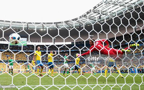 Andreas Isaksson of Sweden dives in vain as Wes Hoolahan of Republic of Ireland scores his team's first goal past Andreas Isaksson of Sweden during...