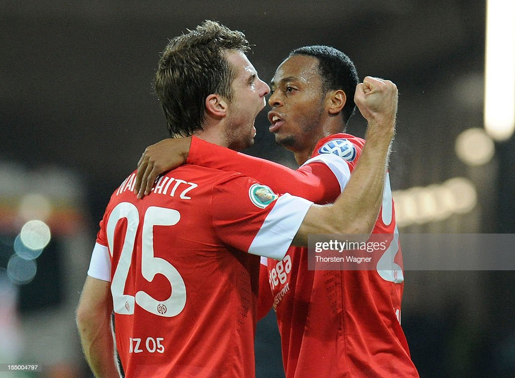 <a gi-track='captionPersonalityLinkClicked' href=/galleries/search?phrase=Andreas+Ivanschitz&family=editorial&specificpeople=2140350 ng-click='$event.stopPropagation()'>Andreas Ivanschitz</a> of Mainz celebrates after scoring his teams first goal during the DFB Cup second round match between FSV Mainz 05 and FC Erzgebirge Aue at Coface Arena on October 30, 2012 in Mainz, Germany.