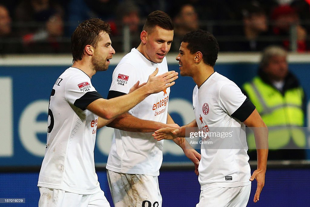 <a gi-track='captionPersonalityLinkClicked' href=/galleries/search?phrase=Andreas+Ivanschitz&family=editorial&specificpeople=2140350 ng-click='$event.stopPropagation()'>Andreas Ivanschitz</a> of Mainz celebrates his team's first goal with team mates <a gi-track='captionPersonalityLinkClicked' href=/galleries/search?phrase=Adam+Szalai&family=editorial&specificpeople=2344504 ng-click='$event.stopPropagation()'>Adam Szalai</a> and Shawn Parker (L-R) during the Bundesliga match between Eintracht Frankfurt and 1. FSV Mainz 05 at Commerzbank-Arena on November 27, 2012 in Frankfurt am Main, Germany.