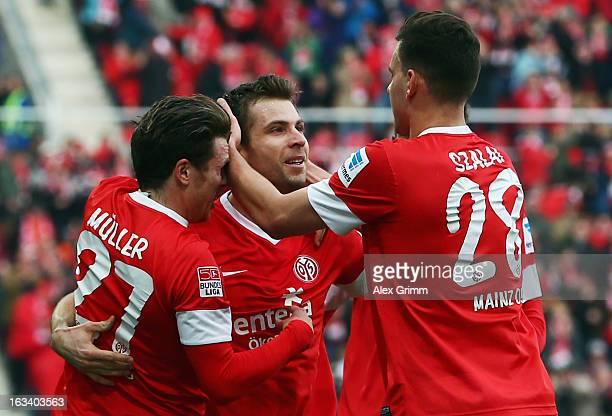 Andreas Ivanschitz of Mainz celebrates his team's first goal with team mates Nicolai Mueller and Adam Szalai during the Bundesliga match between 1...