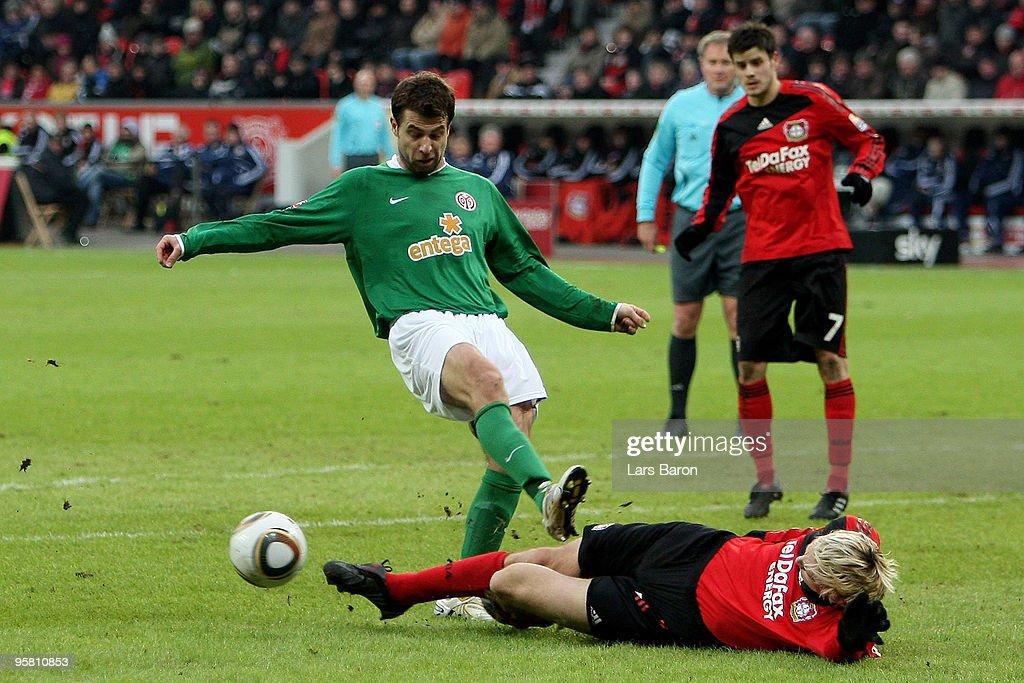 Andreas Ivanschitz of Mainz is challenged by Sami Hyypiae of Leverkusen during the Bundesliga match between Bayer Leverkusen and FSV Mainz 05 at...