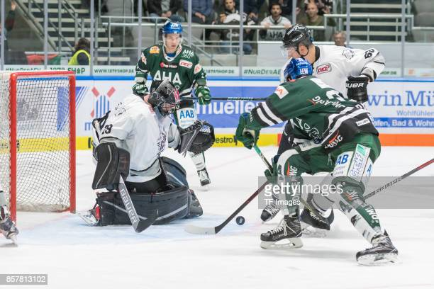 Andreas Jenike of Nuernberg Ice Tigers Matt White of Augsburger Panther TJ Trevelyan of Augsburger Panther and Milan Jurcina of Nuernberg Ice Tigers...