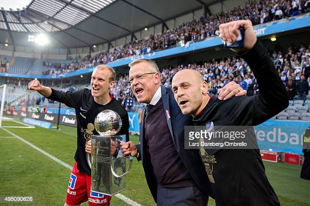 Andreas Johansson Jan Andersson and Daniel Sjslund celebrate winning the Swedish League after the match between Malmo FF and IFK Norrkoping at...