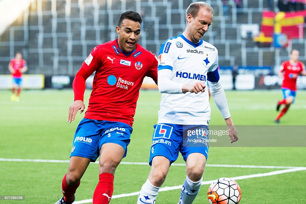 Andreas Johansson of IFK Norrkoping and Matthew Rusike of Helsingborgs IF competes for the ball during the Allsvenskan match between IFK Norrkoping and Helsingborgs IF at Ostgotaporten on May 2, 2016 in Norrkoping, Sweden.