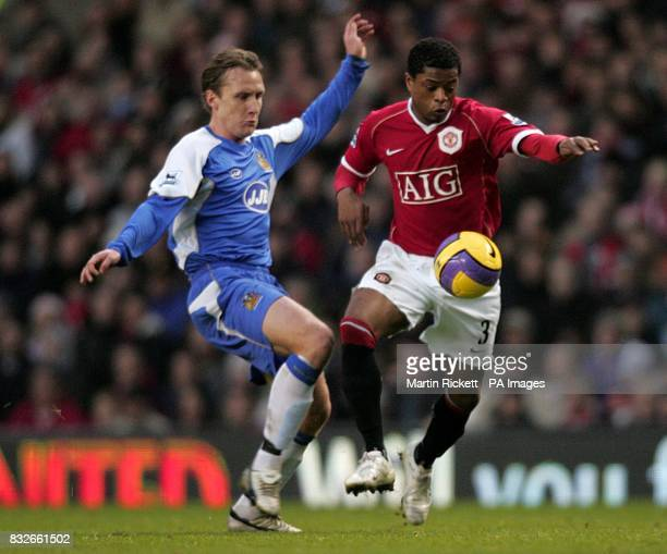 Andreas Johansson Wigan and Patrice Evra Manchester United battle for the ball