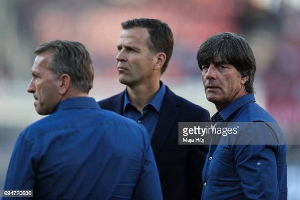 Andreas Koepke Germany goalkeeper coach Joachim Loew coach of Germany and Oliver Bierhoff Germany business manager stand prior to the FIFA 2018 World...