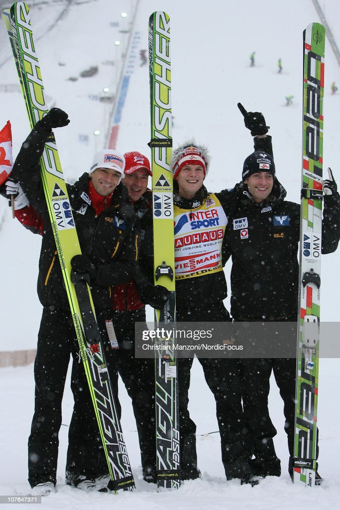 <a gi-track='captionPersonalityLinkClicked' href=/galleries/search?phrase=Andreas+Kofler&family=editorial&specificpeople=722955 ng-click='$event.stopPropagation()'>Andreas Kofler</a> (second) of Austria celebrates with his coach Alex Pointner of Austria, winner <a gi-track='captionPersonalityLinkClicked' href=/galleries/search?phrase=Thomas+Morgenstern&family=editorial&specificpeople=221616 ng-click='$event.stopPropagation()'>Thomas Morgenstern</a> of Austria and <a gi-track='captionPersonalityLinkClicked' href=/galleries/search?phrase=Wolfgang+Loitzl&family=editorial&specificpeople=2139272 ng-click='$event.stopPropagation()'>Wolfgang Loitzl</a> of Austria after the individual HS137 during in the FIS Ski Jumping World Cup on December 17, 2010 in Engelberg, Switzerland.