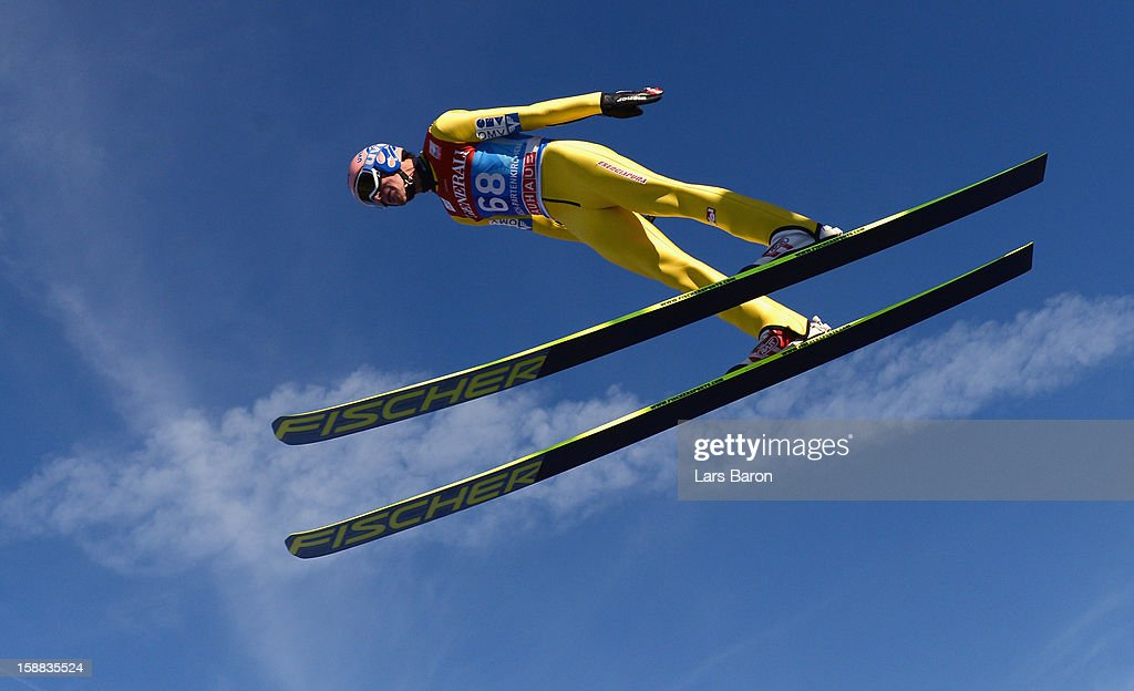 <a gi-track='captionPersonalityLinkClicked' href=/galleries/search?phrase=Andreas+Kofler&family=editorial&specificpeople=722955 ng-click='$event.stopPropagation()'>Andreas Kofler</a> of Austria competes during the trail round for the FIS Ski Jumping World Cup event at the 61st Four Hills ski jumping tournament at Olympiaschanze on December 31, 2012 in Garmisch-Partenkirchen, Germany.