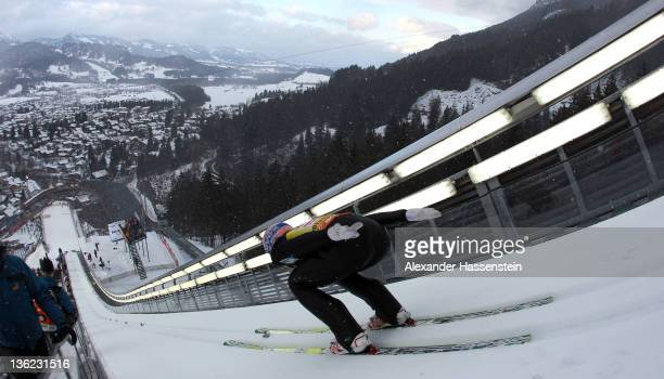 Andreas Kofler of Austria competes during the training round for the FIS Ski Jumping World Cup event of the 60th Four Hills ski jumping tournament at...