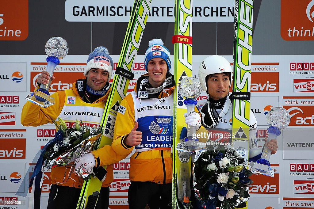 Andreas Kofler (L, 2nd place) of Austria, Gregor Schlierenzauer (C, 1st place) of Austria and Dalki Ito (R, 3rd place) of Japan pose on the podium after the FIS Ski Jumping World Cup event at the 60th Four Hills ski jumping tournament at Olympiaschanze on January 1, 2011 in Garmisch-Partenkirchen, Germany.