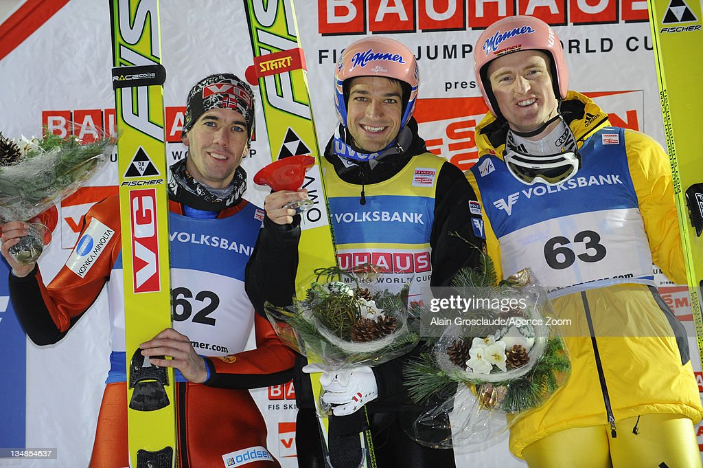 <a gi-track='captionPersonalityLinkClicked' href=/galleries/search?phrase=Andreas+Kofler&family=editorial&specificpeople=722955 ng-click='$event.stopPropagation()'>Andreas Kofler</a> of Austria (first place), Severin Freund of Germany (L) and <a gi-track='captionPersonalityLinkClicked' href=/galleries/search?phrase=Anders+Bardal&family=editorial&specificpeople=2146620 ng-click='$event.stopPropagation()'>Anders Bardal</a> of Norway (second place) on the podium during the FIS Ski Jumping World Cup HS138 on December 4, 2011 in Lillehammer, Norway.