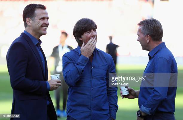 Andreas Kopke Germany goalkeeper coach and Joachim Loew coach of Germany speak with Oliver Bierhoff Germany business manager prior to the FIFA 2018...
