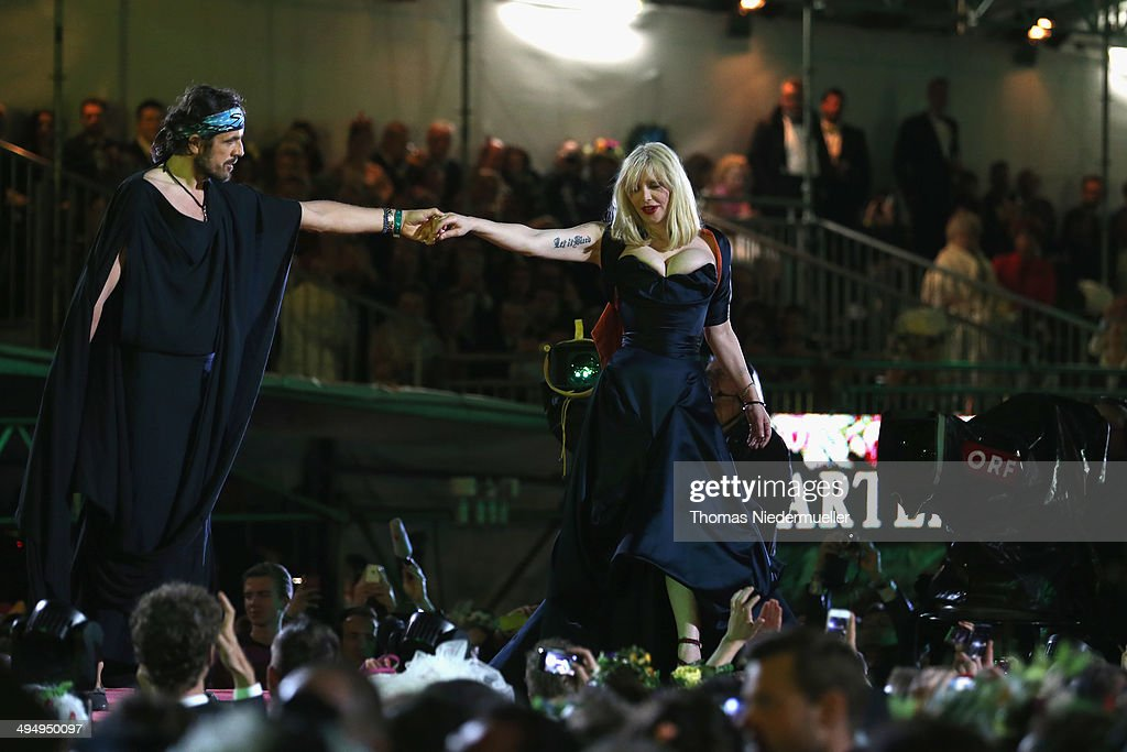 Andreas Kronthaler and Courtney Love seen on stage during the Lifeball 2014 at City Hall on May 31, 2014 in Vienna, Austria.