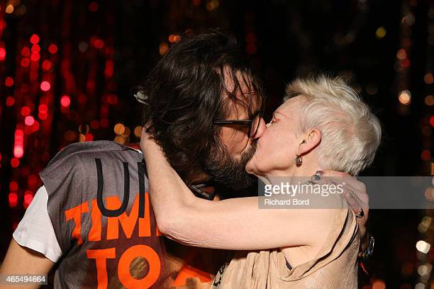 Andreas Kronthaler and Vivienne Westwood share a kiss on the runway after the Vivienne Westwood show as part of the Paris Fashion Week Womenswear...
