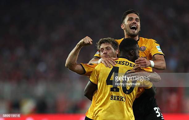 Andreas Lambertz of Dresden celebrates after scoring his team's second goal with Pascal Testroet and Erich Berko of Dresden during the Second...