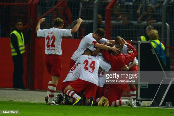 Andreas Laurito of Regensburg celebrates with teammates after scoring his team's second goal during the Second Bundesliga relegation match between...