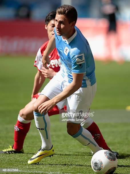 Andreas Ludwig of Muenchen challenges Kazuki Nagasawa of Koeln during the Second Bundesliga match between TSV 1860 Muenchen and 1 FC Koeln at Allianz...