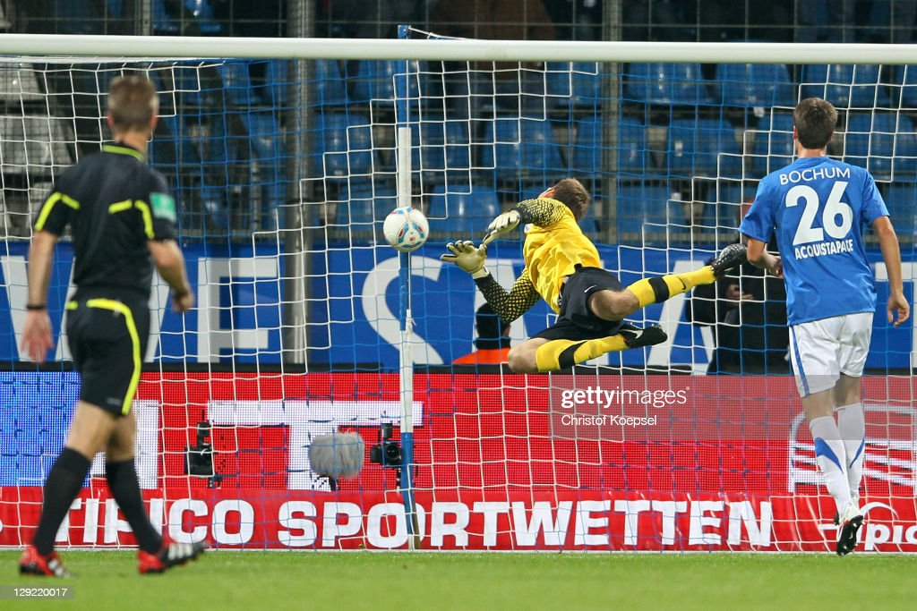 Andreas Luthe and Jonas Acquistapace of Bochum get the second goal by Benjamin Koehler of Frankfurt (not in the picture) during the Second Bundesliga match between VfL Bochum and Eintracht Frankfurt at Rewirpower stadium on October 14, 2011 in Bochum, Germany.