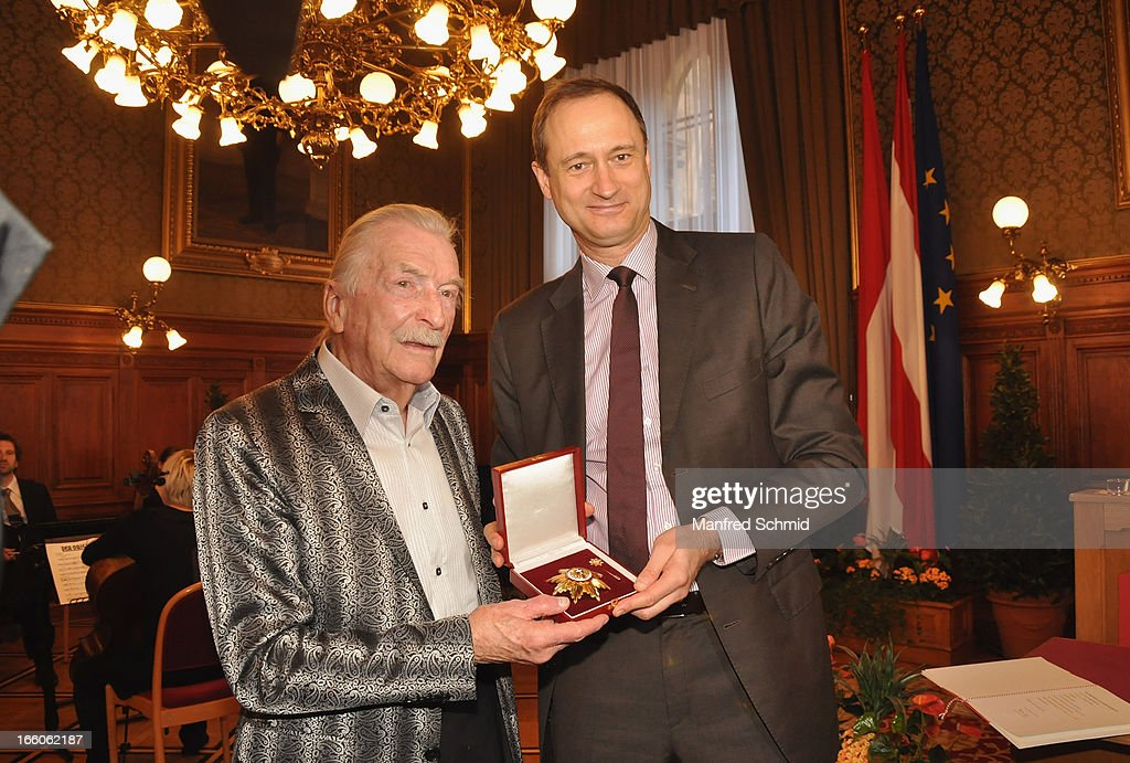 Andreas Mailath-Pokorny presents James Lastwith the 'Goldenes Ehrenzeichen fuer Verdienste um das Land Wien' given in the Rathaus Wien on April 8, 2013 in Vienna, Austria.