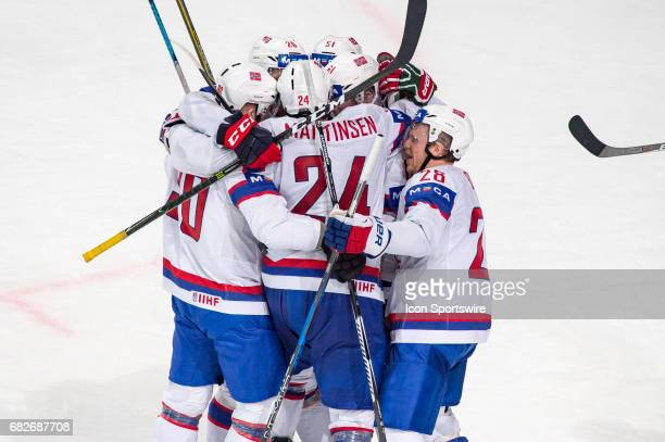 Andreas Martinsen celebrates his goal with teammates during the Ice Hockey World Championship between Norway and Finland at AccorHotels Arena in...