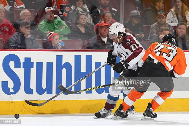 Andreas Martinsen of the Colorado Avalanche skates past Brandon Manning of the Philadelphia Flyers at Wells Fargo Center on November 10 2015 in...