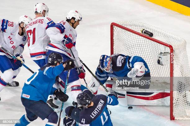 Andreas Martinsen scores a goal against Goalie Steffen Soberg during the Ice Hockey World Championship between Norway and Finland at AccorHotels...