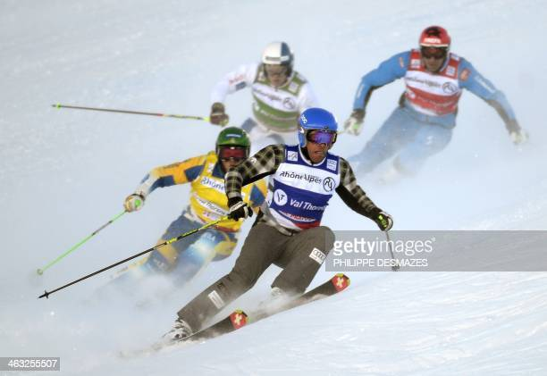Andreas Matt Christopher Delbosco of Canada Jouni Pellinen of Finland and Michael Forsslund of Sweden compete during the FIS men's Skicross World Cup...