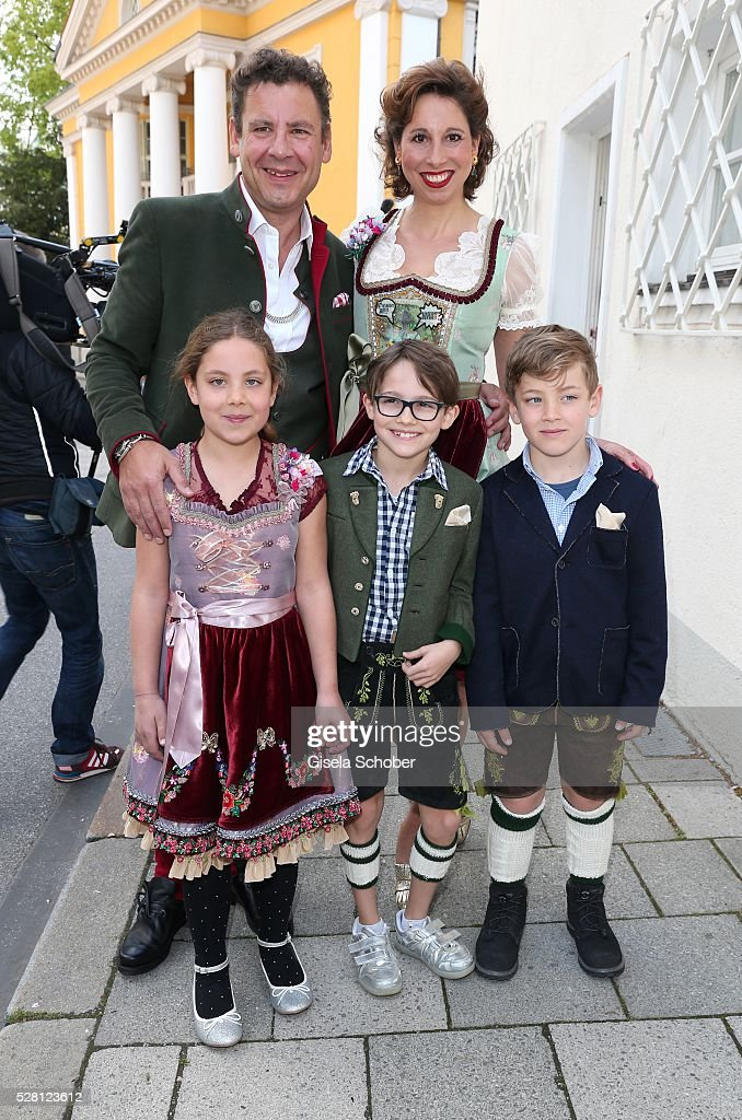 Andreas Meister, brother of David Meister and his girlfriend <a gi-track='captionPersonalityLinkClicked' href=/galleries/search?phrase=Lola+Paltinger&family=editorial&specificpeople=4284453 ng-click='$event.stopPropagation()'>Lola Paltinger</a> and children Lio Paltinger, Maxi Meister, Mia Meister during the wedding of Sophie Wepper and David Meister outside the registry office at Mandlstrasse on May 4, 2016 in Munich, Germany.