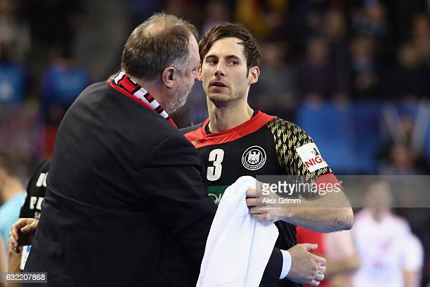 Andreas Michelmann President of the German Handball Federation DHB hugs team captain Uwe Gensheimer of Germany after the 25th IHF Men's World...