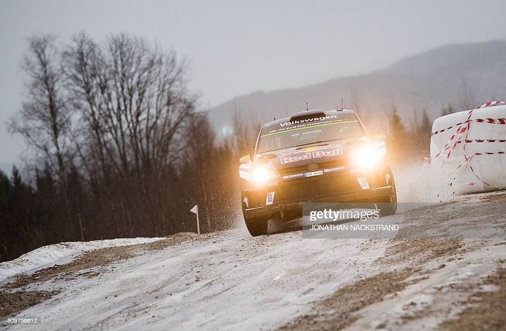 Andreas Mikkelsen of Norway and his co-driver Anders Jaeger steer their Volkswagen Polo during the 2nd stage of the Rally Sweden, second round of the FIA World Rally Championship on February 12, 2016 in Torsby, Sweden. / AFP / JONATHAN NACKSTRAND
