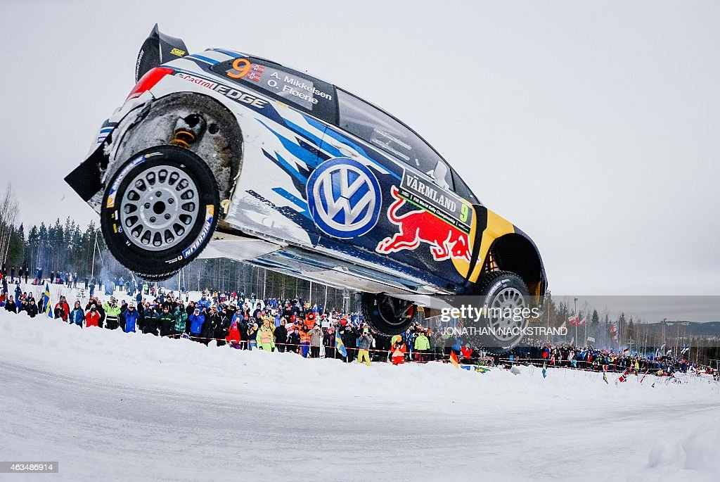 Andreas Mikkelsen of Norway and his codriver Ola Floene of Norway steer their Volkswagen Polo R WRC during the 20th stage of the Rally Sweden second...