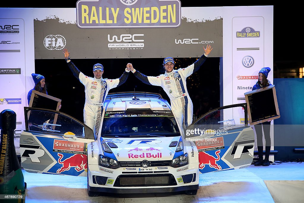 Andreas Mikkelsen of Norway and Mikko Markkula of Finland celebrate their second position in the final podium during Day Three of the WRC Sweden on February 8, 2014 in Karlstad, Sweden.