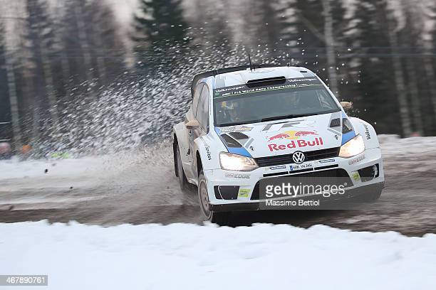 Andreas Mikkelsen of Norway and Mikko Markkula of Finland compete in their Volkswagen Motorsport II Polo R WRC during Day Three of the WRC Sweden on...